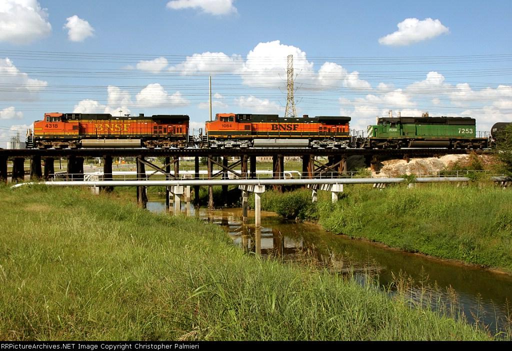 BNSF 4318, BNSF 1064, and FURX 7253