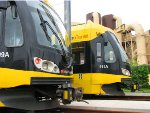 110529065 Hiawatha Light Rail cars wait at end of track along 6th Ave N. near Target Field Station