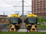 110529067 Hiawatha Light Rail cars wait at end of track along 6th Ave N. near Target Field Station