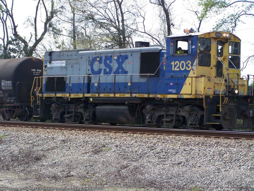 CSX 1203 works it way thru town