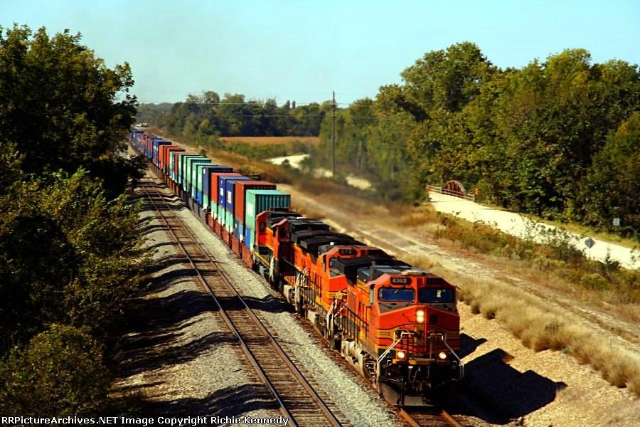 BNSF C44-9W 4363, B40-8W 574, C44-9W 1040, and B40-8 8619 lead an eastbound intermodal.