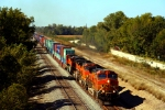 BNSF C44-9W 4363, B40-8W 574, C44-9W 1040, and B40-8 8619 lead an eastbound intermodal.