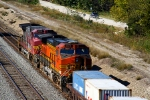 BNSF C44-9Ws 4571 and 606 draw pusher duty on an eastbound stack train.