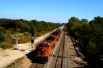 BNSF C44-9Ws 4617 and 5118 pass the pond with a westbound
