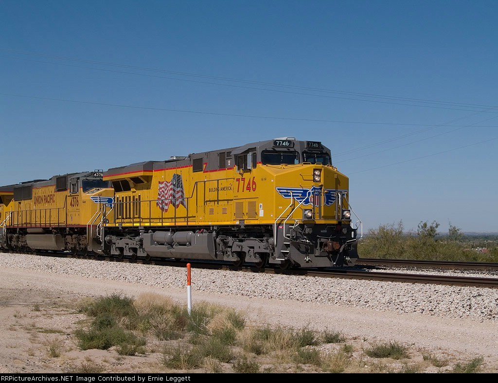 UP 7746 leads an EB manifest at 12:44pm