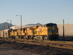 UP 7686 leads an EB manifest out of Alfalfa yard at 5:52pm
