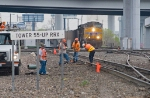 BNSF track gang works at Tower 55 as UP coal load approaches