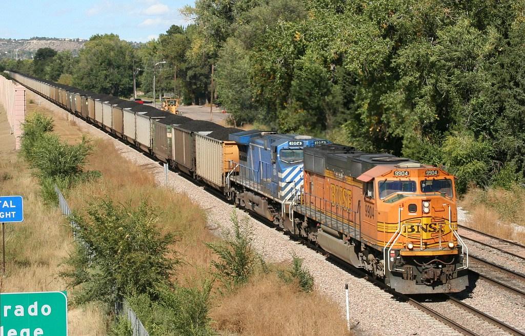 SB BNSF coal train cruising by the siding