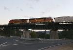 BNSF 9871 pulling a coal train across the Santa Fe bridge after sunset