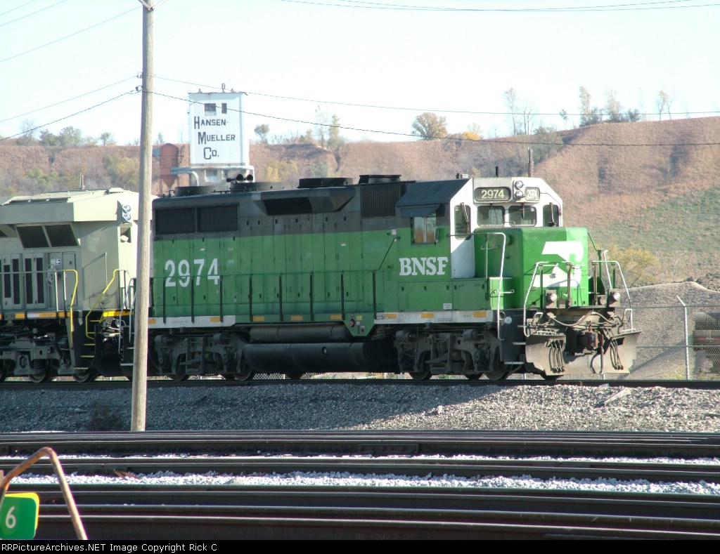 BNSF 2974 Has 2 KCS units in tow with Grain Hoppers