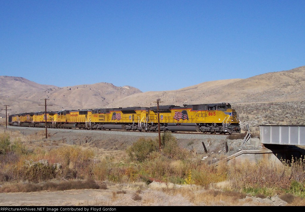 UP 8615 is the lead unit of a mixed freight about to cross Burnt River