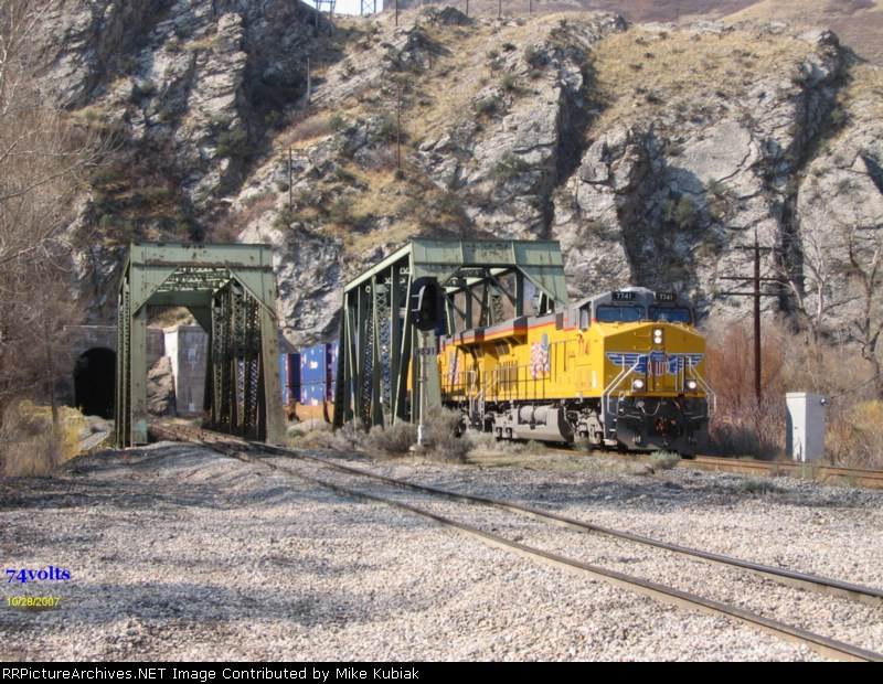 UP 7141 exiting a tunnel and crossing the bridge going east through Weber Canyon near