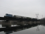 MMRR 24 leads its' train across the Grand River on a cloudy November day