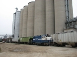 Sandwiched between two cuts of cars, 24 is dwarfed by the silos at King Milling