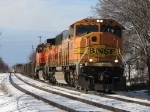 BNSF 9857 & 5644 leading D801 with a banner test awaiting them around the curve