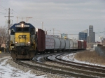 CSX 8414 leading Q326-14 away from the downtown skyline