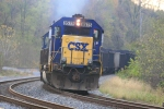 CSX 8575 adds to the morning haze as it shoves 140 loads down the Met