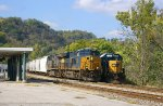 Q648 passes the Depot in Maysville