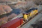 UP 5425 pushes a west bound double stack along Burnt River