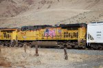 UP 5615 is DPU on rear of UP east bound down Burnt River Canyon