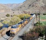 UP 5769 leads westbound along Burnt River Canyon
