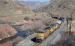 UP 7355 leads an UP double stack out of the Snake River Canyon