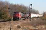 CN freight train takes the signal