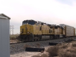 UP 9564 leads an EB autorack at 12:43pm