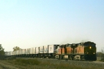 A trio of Dash 9s, 4605, 4435, and 718, lead an eastbound. 