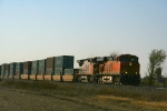 BNSF ES44DC 7613 and C44-9W 938 lead a stack train.