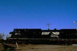 Norfolk Southern C40-9W 9814 leads an westbound by the Louisiana Terrace Crossing.