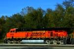 BNSF ES44AC 5856 leads a westbond KPL train through Lawrence