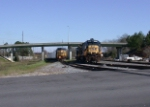 CSX 7693 with brand new hoppers from HOG yard passing local power
