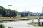 Three sets of power fight for track on the NE of the yard
