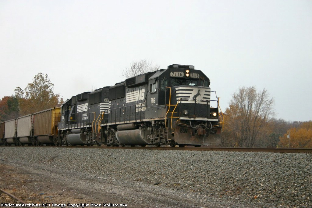 NS 7116 takes Nipsco hoppers up the hill