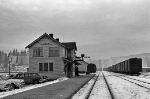 It's a cold November day in 1959 at Quesnel, BC.  The sheets hanging on the clothes line out the left side of the station are frozen solid!  The paddles of the rail signals on the right side of the station orders trains to stop.  Conductors must sign the