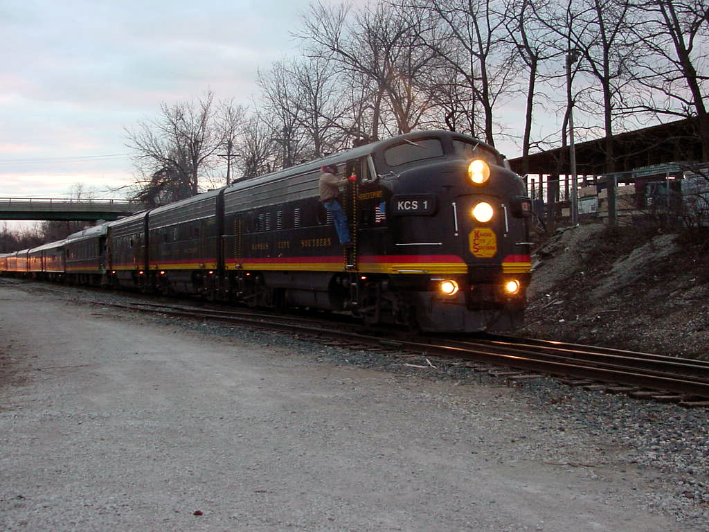 KCS Southern Belle Pulling into Blue Springs with the Holliday Express (off picture but you can see it reflection on the back cars)