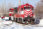WSOR 3807 and two MP15s idle outside the Villard Ave. shops