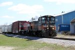 WSOR 1502 leads 1505 and a four-car L249 west through town