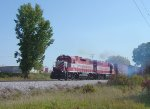 T009 departs for Horicon in a cloud of EMD 645 smoke
