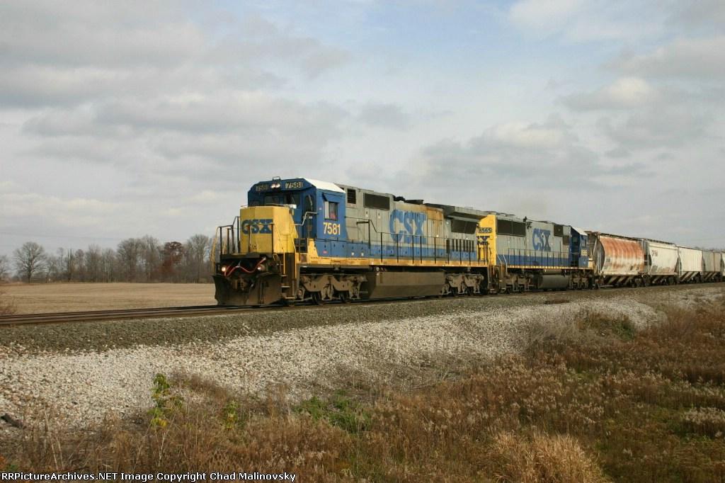 CSX 7581 takes grain empties back to the CP Rail