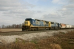 CSX 7581 takes grain empties back to the CP Rail
