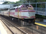 MBTA F40PH 1057 pushes its train towards Boston on a hot summer afternoon 2007