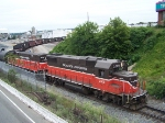 PW 2009 and 3006 switching cars at the Port of Providence on a drab summer day!