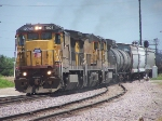 Union Pacific 9025 leads a trio of locomotives and long freight