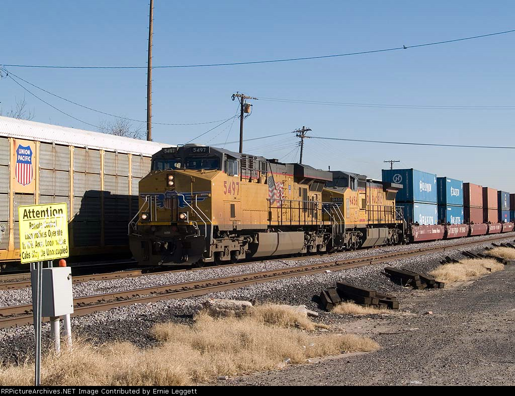 UP 5497 leads a WB doublestack at 2:01pm