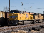 UP 7736 leads a WB doublestack at 1:12pm