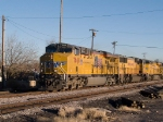 UP 7668 leads a WB doublestack at 4:20pm