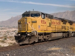 UP 9554 leads a WB autorack at 12:12pm