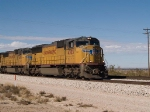 UP 4303 leads an EB doublestack at 12:27pm